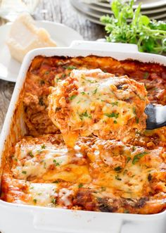 Chicken Lasagna alla Bolognese - a classic lasagna recipe using ground chicken and pancetta for the Bolognese sauce. Simple to make and a favorite comfort food.