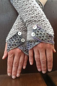 "Knitting Pattern for Aotearoa Mitts - ""Aotearoa"" is the name Maori people have for their country (what we know as New Zealand), meaning ""The Long White Cloud"". These fingerless mitts feature cloud inspired lace and a decorative flap over the fingers that creates the thumb hole. Fingering yarn. Designed by Sabine Kastner"