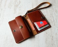Leather wallet women from NeroccoCases: We call this genuine leather wallet from NeroccoCases The Little Big Why? You can put - many of cards (6-8) - folded cash and - coins in an unbelievable area of 3 by 4,5 (7,5cm by 11cm). And you can carry the closeable leather wallet with