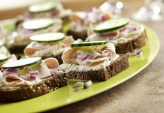 Dainty quarters of turkey and herbed cheese spread sandwiches on whole grain bread make a perfect snack for after school or anytime! It's okay to have more than just one. Simple appetizer recipes have never been cuter or tastier. Enjoy.