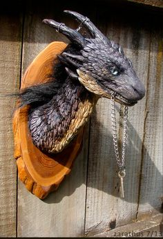 Faux taxidermy is one of my new favorite things!  Fake taxidermy fur dragon sculpture by staticcreature on Etsy
