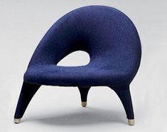 A rarely-seen but exemplary example of mid-century Scandinavian art furniture, Swedish designer Folke Jansson's 1955 Arabesk Chair.