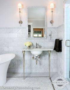 Marble tiled walls, marble wainscoting & marble tile clad walls. (nice border idea on floor for smaller footprint bathroom)