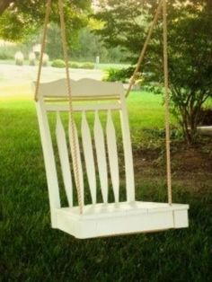 Broken chair recycled into swing or could be used as swing to put flowers on or even on front porch for packages, books, etc.