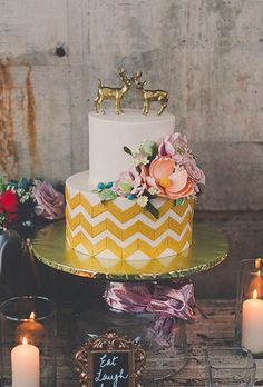 Gold-painted deer make a rustic wedding cake topper | Brides.com
