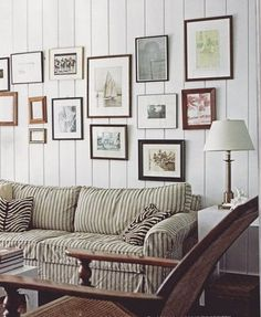 India Hicks, living room. Striped ticking on sofa, textured walls.