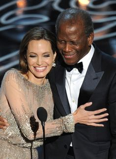 #AngelinaJolie and #SidneyPoitier get friendly while presenting at the 2014 #AcademyAwards.  #Oscars