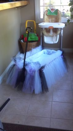 This adorable wagon was decorated in an afternoon with tulle, ribbon and adhesive backed velcro strips.