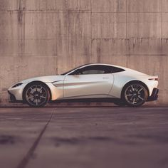 with ・・・ Pure, sculptural forms create a muscular stance for the A design intent on expressing its agility and dynamism. Aston Martin Dbs, Aston Martin Vantage, Jaguar, Ferrari, Jeep, Bmw, Latest Cars, Car Pictures, Sport Cars