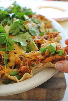 Slow cooker chicken nachos..sounds like something to try.  Might even be better with ground sirloin or Laura's Lean beef.