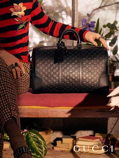 Crafted in Gucci Signature debossed leather, a duffle bag from Gucci Pre-Fall 2016 by Alessandro Michele.