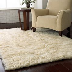 These rugs are fun, retro and shaggy and make great throws for the foot of the bed. Flokati Shag Rug - Natural $119.99