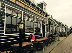 A beautiful walkway by the quay with typical Dutch restaurants .   Maarken, noord Amsterdam !