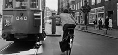 1950's. Trying to mail a letter using the postbox in a moving tram in Amsterdam. Photo Eddy de Jongh. #amsterdam #1950's