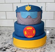Rescue Bots Chase cake. This is almost exactly what I want to do, but I need Heatwave instead!