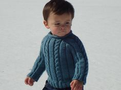 The Pridie Baby pullover is a traditional looking Aran knit sweater with a modern day twist. With a rolled ribbed collar, cable/ribbed body and cuffs, allows for a very stretchy fabric to give your baby the perfect fit it deserves. Boys and Girls alike will look adorable wearing this one of a kind classic.