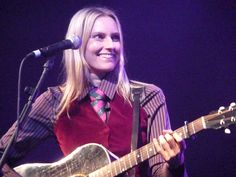 Aimee Mann in concert in October American rock singer-songwriter, bassist and guitarist. She was the bassist and a vocalist for the band 'Til Tuesday during the and since then she has primarily released albums and performed as a solo musician. The Band Songs, Pop Playlist, Woman Singing, Duke Ellington, Rock And Roll Bands, Louis Armstrong, Female Singers, Pop Music, Concert