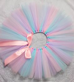 This beautiful tricolour watercolour tutu is perfect for cake smash pictures on your darlings first birthday! Made with plenty of soft layers for a very full, poufy result. The waist is adjustable so it can continue to be worn to make any average day extraordinary for you little princess. If you have any concerns about sizing, please feel free to contact me! I can create custom orders as well - many colours available! Standard sizes are as follows. The waist can be adjusted an inch or two…