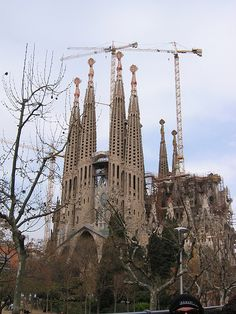 Built by Antoni Gaudi. Started in 1882 La Sagrada Familia (Temple of the Holy Family) was his vision of Europe's biggest cathedral. This shows some of the building work. There are more cranes and metal bars than towers and bricks in this cathedral   Excursions in Barcelona Excursions in Barcelona Holidays in Barcelona Sightseeing tours, airport transfers, taxi, interpreter and your personal guide in Bar