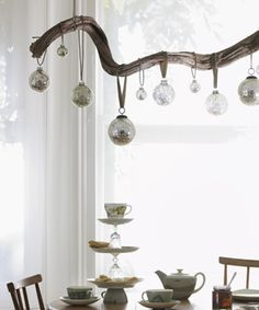 for over the dining table, but with a mix of hanging tea light holders and baubles