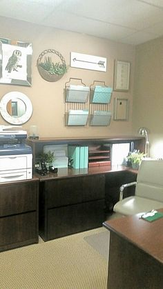I would add a bigger more decorative mirror because it will make the space seem even bigger. The file holders could be colored too. I would have some of those watercolor paintings on the wall here. All of this would be the wall behind your desk.
