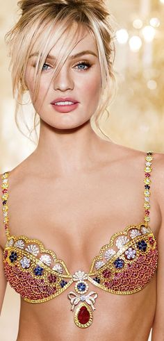 Candice Swanepoel is wearing the 10 million $ Fantasy Bra designed by MOUAWAD Jewelry (52-carat pear-shaped ruby).