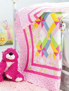 "Satisfy your sweet tooth with this sugary and simply adorable baby quilt.   Refresh a traditional quilt pattern with happy fabrics. This fabric placement gives the illusion of chevrons and pinwheels. This e-pattern was originally published in the Spring 2014 issue of  Quilter's World  magazine. Finished size is 50 1/8"" x 61 1/2"". another photo downloaded on evernote"