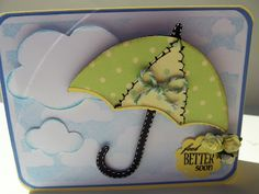 Clouds are from Pooh and Friends Cricut Cartridge Umbrella is from Paisley Cricut Cartridge