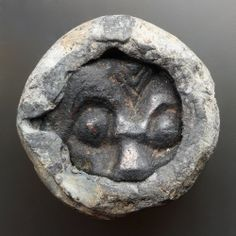 Lead weight, 29 mm diameter, with inset fragment of insular metalwork.