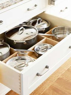 Deep, roll-out drawer with adjustable dividers sized to fit your go-to pots.