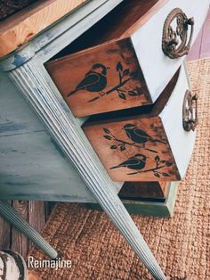 Home decor details: bird and leaf pattern stenciled on the outside of the drawers of an antique chest.