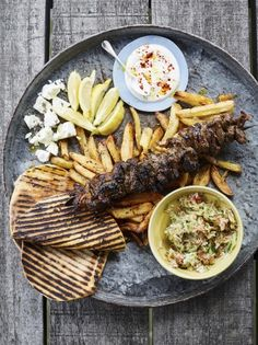 Epic lamb kebabs Gnarly lamb, homemade chips, slaw and warm flatbreads – this lamb kebab recipe from Jamie Oliver is truly epic! As seen on Friday Night Feast. Fruit Kebabs, Lamb Kebabs, Kabobs, Skewers, Kebab Recipes, Lamb Recipes, Roast Recipes, Dinner Recipes, Batch Cooking