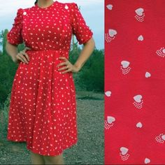 "VINTAGE Red Dress with White Hearts DETAILS  1970s/1980s secretary dress. Shoulders are gathered with a small white button at each, elastic waist is stretchy & comfy. Maker is Doo-Dads. No material tags, probably polyester. Would fit a modern size 12-14 comfortably.  MEASUREMENTS  (taken flat, then doubled): Bust: 40"" Waist: 26""-38"" Hip: Open Sleeve: 8"" Total length: 42""  Model is 5'8"", 38DDD-31-40.  CONDITION  Belt loops snipped off. One small snag on the front of the dress. Both are shown…"