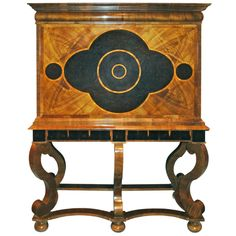A Biedermeier style cabinet-on- stand   From a unique collection of antique and modern cabinets at https://www.1stdibs.com/furniture/storage-case-pieces/cabinets/
