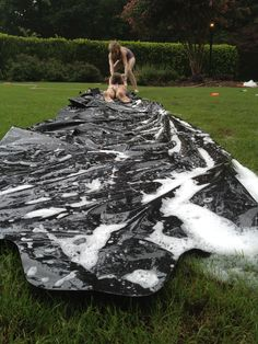 Homemade Slip-n-slide! Perfect for any summer day! Jut tape together garbage bags, secure it with some stakes (the type that hold x-mad lights) lather with soap and water and slide! Perfect DIY craft!