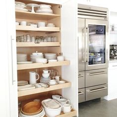 In my next house, I want a dish pantry just like Heather Bullard's. When I'm designing the kitchen, I would place it next to (or near) the dishwasher. (https://twitter.com/Heather_Bullard/status/509799826331287552/photo/1)