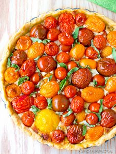 Vibrant Fresh Tomato Tart with a creamy cheesy base and buttery crust. This spin on the classic southern tomato pie is a winner in taste and visual appeal! Vegetarian Recipes, Cooking Recipes, Healthy Recipes, Southern Tomato Pie, Tomato Tart Recipe, My Favorite Food, Favorite Recipes, Vegetable Side Dishes, Vegetable Recipes