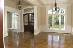 Double front door and wainscoting-I love all of the windows!!