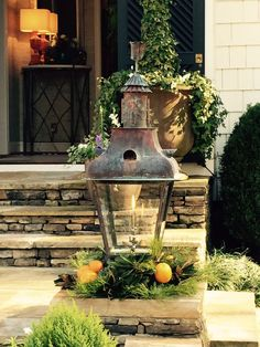 The lanterns on the walkway were decorated with oranges and greenery mimicking the front door wreath.