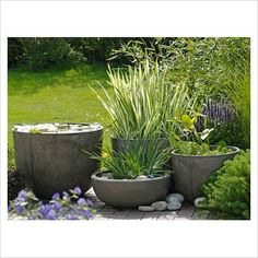 Grouped container ponds- good idea repined by www.claudiadeyongdesigns.com and www.thegardenspot.co.uk