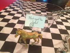 Toy horses from the Dollar Store, poked a wire in the top twisted so it would hold cards telling what was being served in each dish.