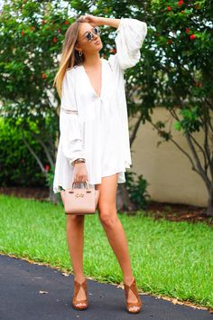 Miu Miu sunglasses, Tory Burch shoes and Free People dress and Ted Baker bag in all white outfit of fashion blogger Tanya Litkovska