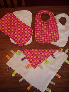 Baby girl gift set  2 burp clothes, 2 bibs, taggie blanket