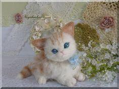 Very sweet needle felted kitten
