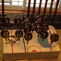 Hockey Puck cake pops made of Ding Dongs. Let's Go Pen!!