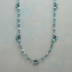 """SEA SPRAY NECKLACE--To wrap or wear long, a handcrafted necklace by Jane Diaz contrasting the steely gray of oxidized sterling silver and the fresh seaborne shades of faceted apatite. Sterling silver hook. 36""""L."""