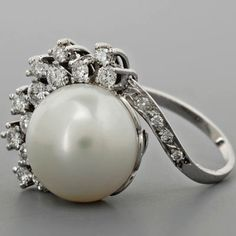 vintage pearl ring with tiny diamond accents..if i ever get maried this is the ring i would want!!!!!!!!!!!!!!!!!!!!!!