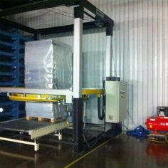 Automated pallet wrapping machine.