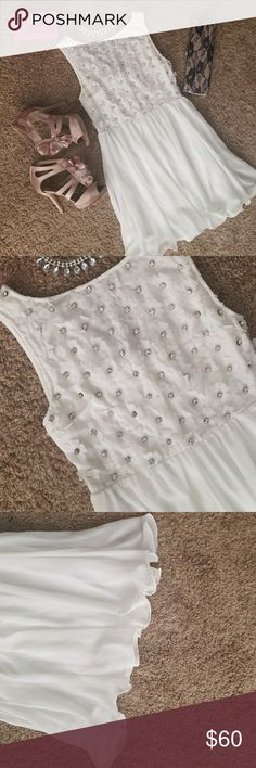 LF flowy white floral mini dress with rhinestones Worn once only to my graduation. Very delicate dress, chiffon like material. Flowers on bust area embellished with rhinestones. In perfect condition. TFNC London from LF store LF Dresses Mini