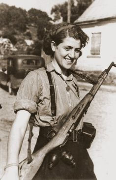 Sara Ginaite-Rubinson, a female partisan, at the liberation of Vilnius, Lithuania (July 13, 1944). The photograph was taken by a Russian-Jewish Red Army major who was surprised to see a female Jewish fighter standing guard.